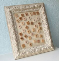 love this magnetic board with scrabble tile magnets