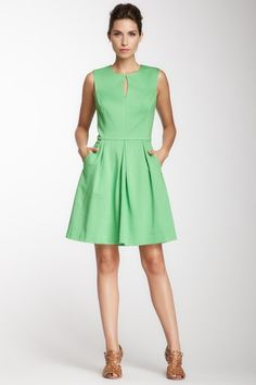 Cute green dress... a burnt orange or camel sweater or jacket would compliment this dress...