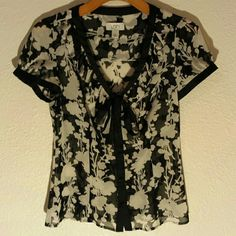Loft Top Sheer black and white with floral print. Ruffle detail around the collar. Bow at the v neck. Buttons down front. LOFT Tops
