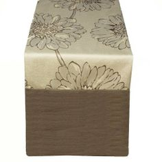 Large Floral Pattern 90x18 inch Table Runner; Brown by Wildflower Linens. $100.70. Front 100-percent cotton back 60-percent cotton 40-percent polyester; Machine wash cold gentle cycle; Lay flat to dry. The Caprice Brown runner will make a bold statement and beautiful accent to any home. The flowers in this collection are light and fun and give a natural setting to any table.. Save 33% Off!