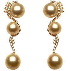 Golden pearl, diamond, and gold earrings by Jewelmer