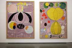 "Hilma af Klint: Painting the Unseen | a trio of vivid, room-high Altarpieces - metallic discs, jutting pyramids & prisms of rainbow colour, an element of her monumental cycle ""The Paintings for the Temple"" (1906-15) representing ""the immortal aspects of man"" esoteric symbolism of spirals, shells, letters & warm-solar goldish red colours (=masculine) or cool lunar blue-lilac colours (= feminine) akin to Polish visionary St Faustina'Divine Mercy image & green (= harmony) uniquely communicative"