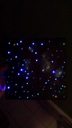 Galaxy painted graduation cap with fiber optic lights