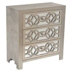 "Featuring latticework overlay and mirrored drawer fronts, this lovely 3-drawer chest brims with distinctive style for your living room or den.    Product: ChestConstruction Material: Engineered wood, fir wood and mirrored glassColor: GreyFeatures: Three mirrored drawersDimensions: 28"" H x 26"" W x 12"" D"