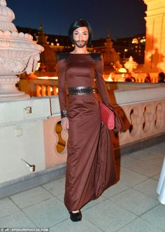 Conchita Wurst pictured dressed in brown at the Diversity Ball in Vienna in April 2012.