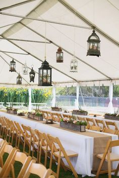 Southern wedding - tent wedding ideas..love the hanging lanterns and wooden chairs