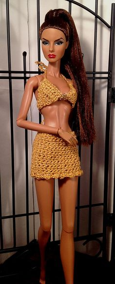 Agnes still trying on new bathing suits for her trip. This one is has a gold thread through it, and shimmers so sweet on her skin tone.