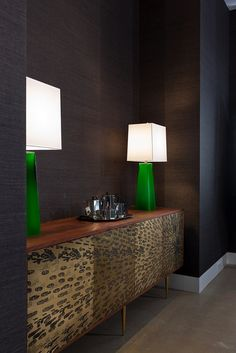 modlin modern dining room detail | schumacher black grasscloth | arteriors green glass lamps | organic modernism brass and walnut sideboard | photo by jeremy enlow | 360 west magazine august 2012