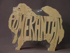 """haha - it a """"toy""""! Pomeranian Dog Animal Puzzle Wooden Toy Hand  Cut by Puzzimals, $12.00"""