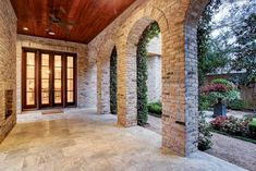 3843 Chevy Chase Drive, Houston, TX 77019: Photo Downstairs covered loggia with fireplace is accessible from kitchen and has views of yard and gardens.