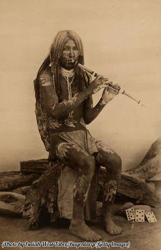 A Yuma man playing a flute, Arizona, 1900