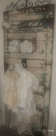 Love love love love.  Vintage Chippy Wooden Door From Which Vintage Children's Clothing Is Hung