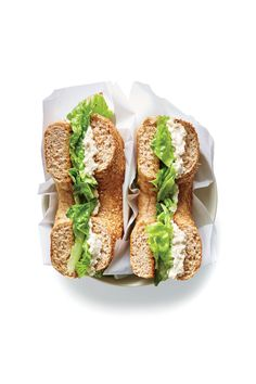 "Caesar Bagels | Enjoy this crunchy, creamy bagel sandwich for breakfast, lunch, or dinner. The cream cheese ""schmear"" itself should become a fridge staple; it tastes just like Caesar salad dressing but is thick and spreadable. Try it on toast, on a burger, or stirred into scrambled eggs for a savory boost. We prefer whole-wheat bagels, but you can also opt for onion bagels or everything bagels for more allium flavor. Do be sure to grab romaine lettuce; you want a sturdy, crunchy lettuce for…"
