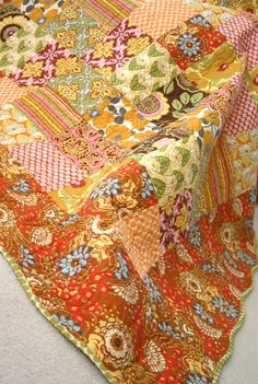 Splash of citrus.  Fabrics are Lotus by Amy Butler.  Nice tutorial on How to make a quilt from start to finish.