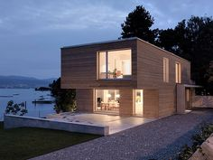 In spring 2006 the builders came to our office with the request - to build a house on Lake Zurich – a dream come true for any architect. Starting point was a parcel of land with a single family hous…