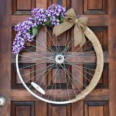 Purple lilac bicycle wheel wreath - purple flowers  A personal favorite from my Etsy shop https://www.etsy.com/listing/527710387/spring-wreath-purple-flower-wreath-lilac