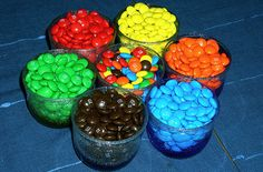 One or two bags of Skittles or M&Ms, separate into cups