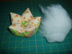 pincushion tutorial...saw lg pillows like this one time...fun shape.