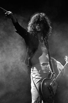 The man that made me want to play guitar, the wizard himself: Mr. Jimmy Page. I've been neglecting the mighty Zep as of late, but don't worry, his sound runs through my veins.