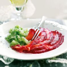 Impress your guests with our beetroot and vodka-cured salmon with pickled cucumber salad recipe
