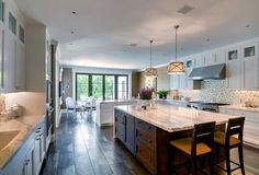 Traditional Kitchen with French doors, slate tile floors, Complex marble counters, U-shaped, European Cabinets, Glass panel