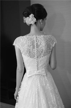 PERFECT. lace, sleeves, buttons, and bow. with a tad lower back and sweetheart neckline in front THIS IS THE IDEAL.
