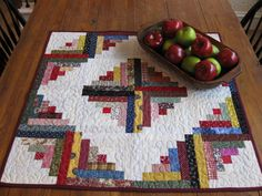 log cabin table topper...Log cabin has always been my favorite quilt pattern!