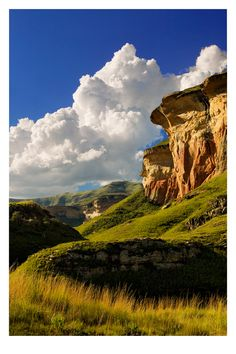 Golden Gate National Park includes the vast colourful sandstone formations, which shine golden-yellow in the evening sun, and from which the area derives its name.     This particular one is called Mushroom Rock, located near the nice town of Clarens.  South Africa
