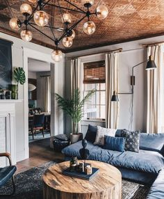 Cozy home with modern traditional style. Modern light fixtures, large wood coffee table, cozy sectional