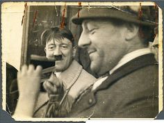 Finally this crazy photo can be posted in higher resolution and in better quality. This is said to be the actual original photo, from 1934, of a wild-haired Hitler watching a man fiddle with a camera. The auction house who sold it says that it was...