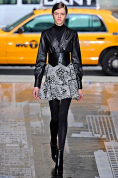 I love this entire DKNY look for the Jaqueline shoe from JustFab but worn separately. The skirt is perfect for the shoe as is the  jacket, but I would wear the jacket with pants and bootie and a killer short peacoat with the skirt and bootie.