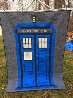 Mama Spark's World: It's A Tardis Any Dr Who fans out there? I finished my Tardis quilt and wanted to take a few minutes to share that here. My son was born the day after Christmas so this is going to be his birthday present. The pattern is called Relatively Dimensional and the words can be purchased from Spoonflower. The quilting is done by Kathy Koch of Thread Bear quilting and it is AMAZING!!