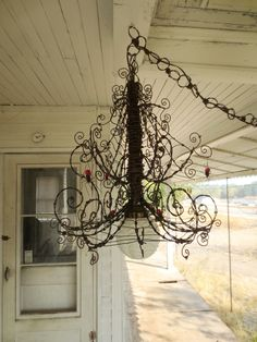 Barbed Wire Chandelier Infested With Spiders and Festooned With Webs. $375.00, via Etsy. Would be better without the spiders