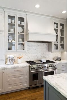 Kitchen Cabinetry | Grey Cabinets | Marble Backsplash & Countertops | Kitchen Cabinet Decision: Glass or Solid Doors? Gallerie B blog