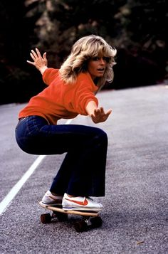 Farrah Fawcett in denim flares and Nike classics #orange