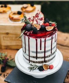 White naked cake and red drip icing.