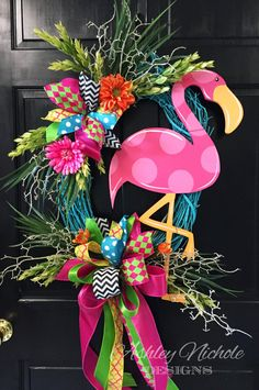 What a cute fun flamingo wreath!!! Flamingo is made of 1/2 plywood. Painted with outdoor quality paint. Painted black on the back for that polished look. Wreath is built on a Turquoise Blue 24 Grapevine Wreath