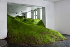 Not Red But Green. Kristian Nygård. Oslo. Filled the exhibition space with a hilly, rolling landscape of actual grassy mounds.