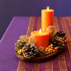 We love this fall craft idea! Decorate pinecones and arrange them around two candles on a tray for an easy holiday centerpiece.