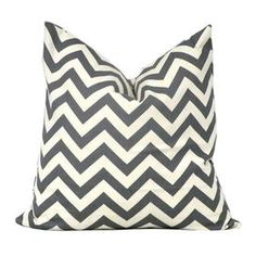 Cotton pillow with a chevron motif and feather down fill. Made in the USA.    Product: PillowConstruction Material: Cotton and feather down fillColor: Charcoal and ivoryFeatures:  Zippered closureSame pattern on front and backInsert includedWill enhance any dcor  Dimensions: 20 x 20Cleaning and Care: Spot clean with gentle cleaner and air dry