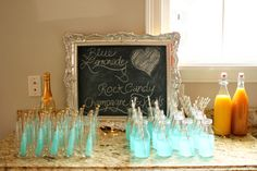 blue lemonade, blue rock candy and champagne cocktail