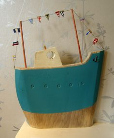 scrap-crafted boat with pennants