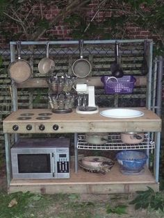 """broken recycled items for a kids """"mud"""" kitchen. Mud Kitchen For Kids, Mud Pie Kitchen, Kitchen Stove, Real Kitchen, Outdoor Play Spaces, Kids Outdoor Play, Outdoor Fun, Outdoor Learning, Outdoor Tables"""