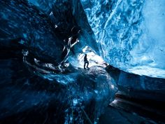 You can travel into an ice cave in a glacier. These caves are sometimes called the 'Crystal Caves.'