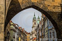 View of the Lesser Bridge Tower from the Charles Bridge,on a cloudy day Prague…