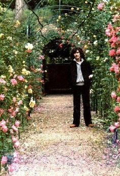 George Harrison in his gorgeous flower garden. I'll bet it's Friar Park. George Harrison, Great Bands, Cool Bands, The Quarrymen, Find A Song, Beatles Love, The Quiet Ones, Simon Garfunkel, The Fab Four