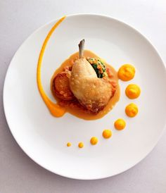 Confit chicken maryland braised cabbage and spinach, potato fondant, spiced carrot purée, chicken cream jus from The ChefsTalk Project