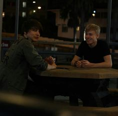 """""""Dude, I think that girl recognizes us."""" """"Oh for sure, look she tries to make a picture."""" Sam smiles."""