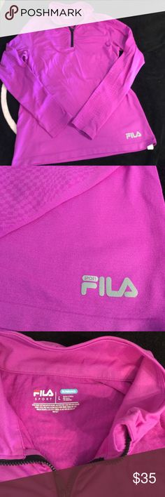 Fila running top size large Fila running top size large.  Looks more like medium but is stretchy and fits large.  Purple. Materials 90% nylon and 10% spandex. Very very soft and stretchy materials. Has thumb holes. Wore one time around the house.  Smoke free home in excellent condition. Fila Tops