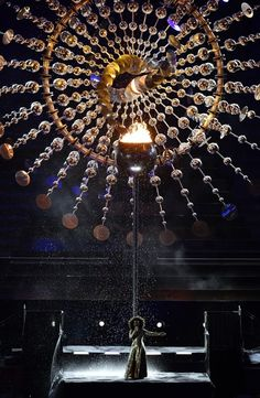 Brazilian singer Mariene de Castro performs beneath the Olympic cauldron during…